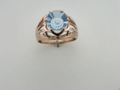 Image de Bague en or rose 10KT sertie d'un topaze bleu
